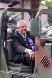 Congressional Medal of Honor recipient Silvestre Herrera is escorted by members of the Arizona National Guard, Nov. 11, during Phoenix's annual Veterans Day parade. Herrera served as the parade's grand marshal. The first Arizonian to receive the Medal of
