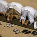 JTF Guantanamo Detainees Kneel As They Observe Morning Prayer