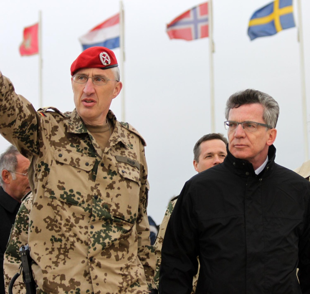 German Minister of Defence walks with the ISAF Regional Command North commander