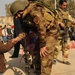 Iraqi special operations forces hand out backpacks