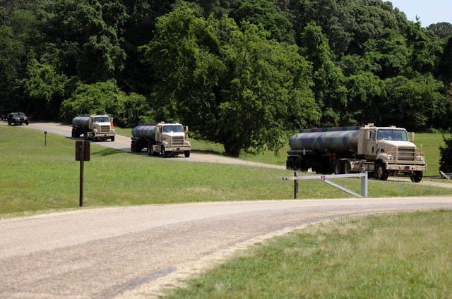 Soldiers from the 705th Transportation Company with their fuel tankers