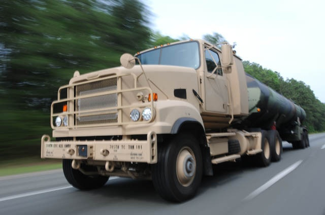 Soldiers hauling JP-8 in a M915A5 line-haul tractor truck