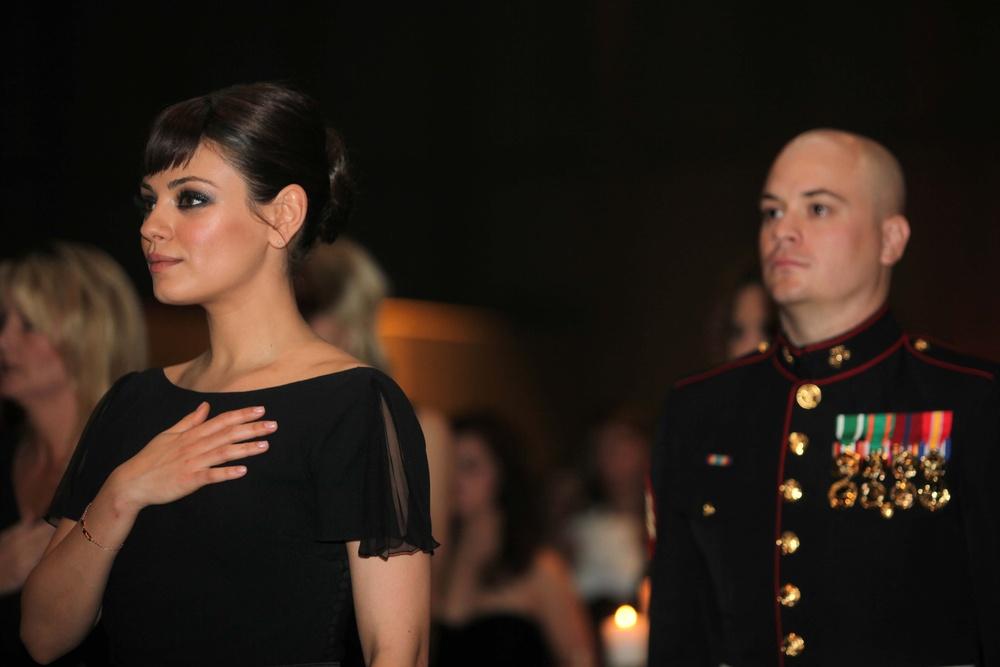 Marine takes actress Mila Kunis to birthday ball