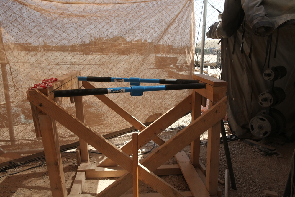 Marine builds gym during down time in Afghanistan
