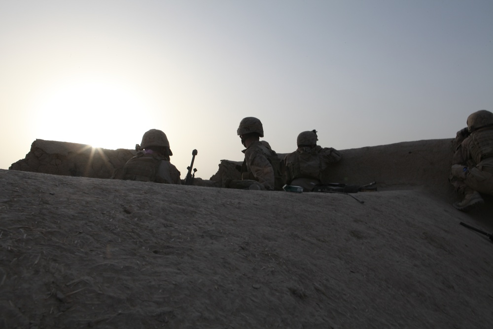 Scout snipers keep watch over Marines
