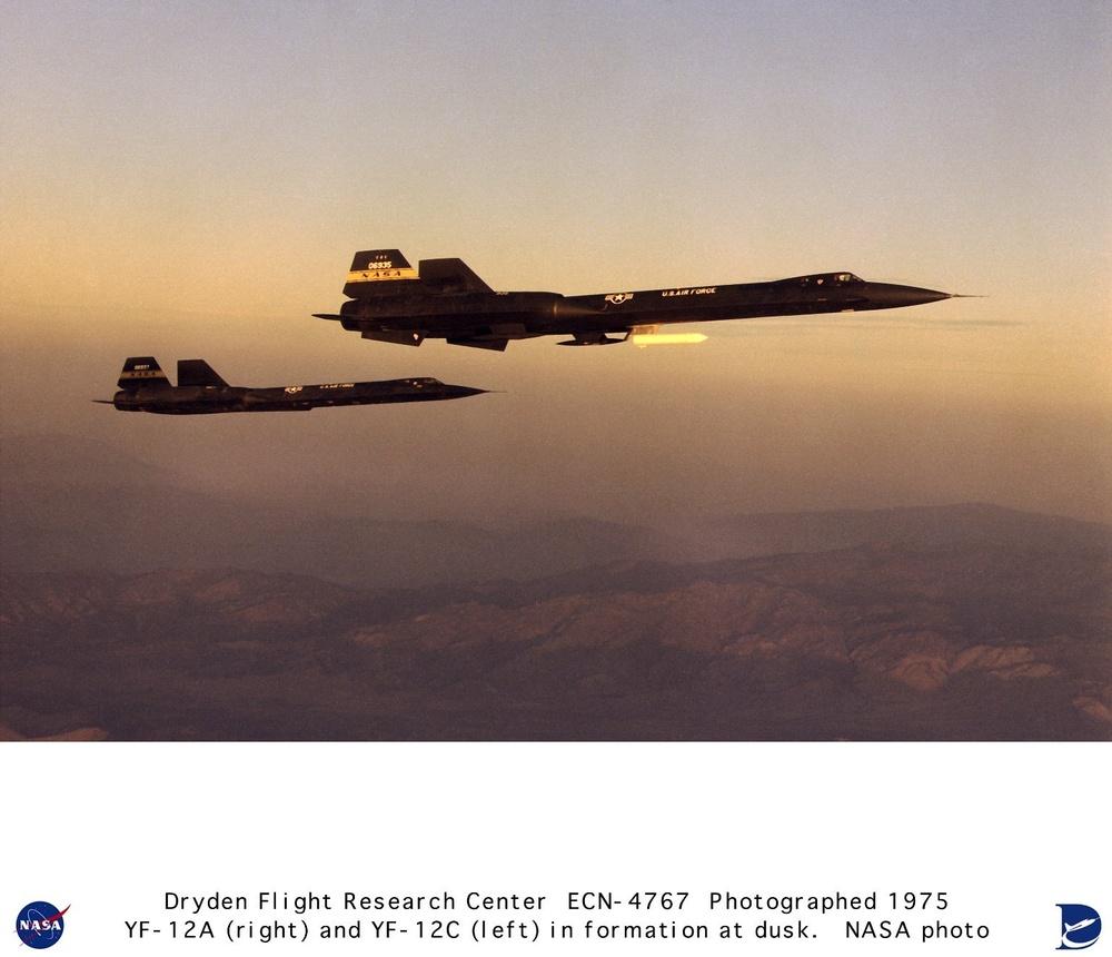 YF-12A and YF-12C in flight formation at dawn