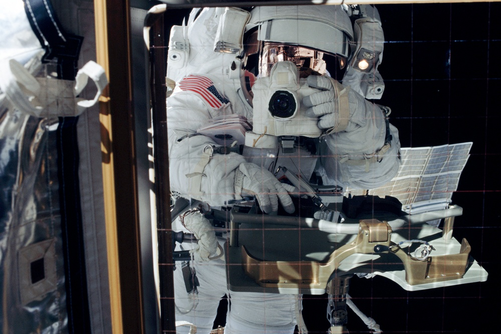 Bursch's reflection in an EETCS radiator during Expedition Four EVA 3