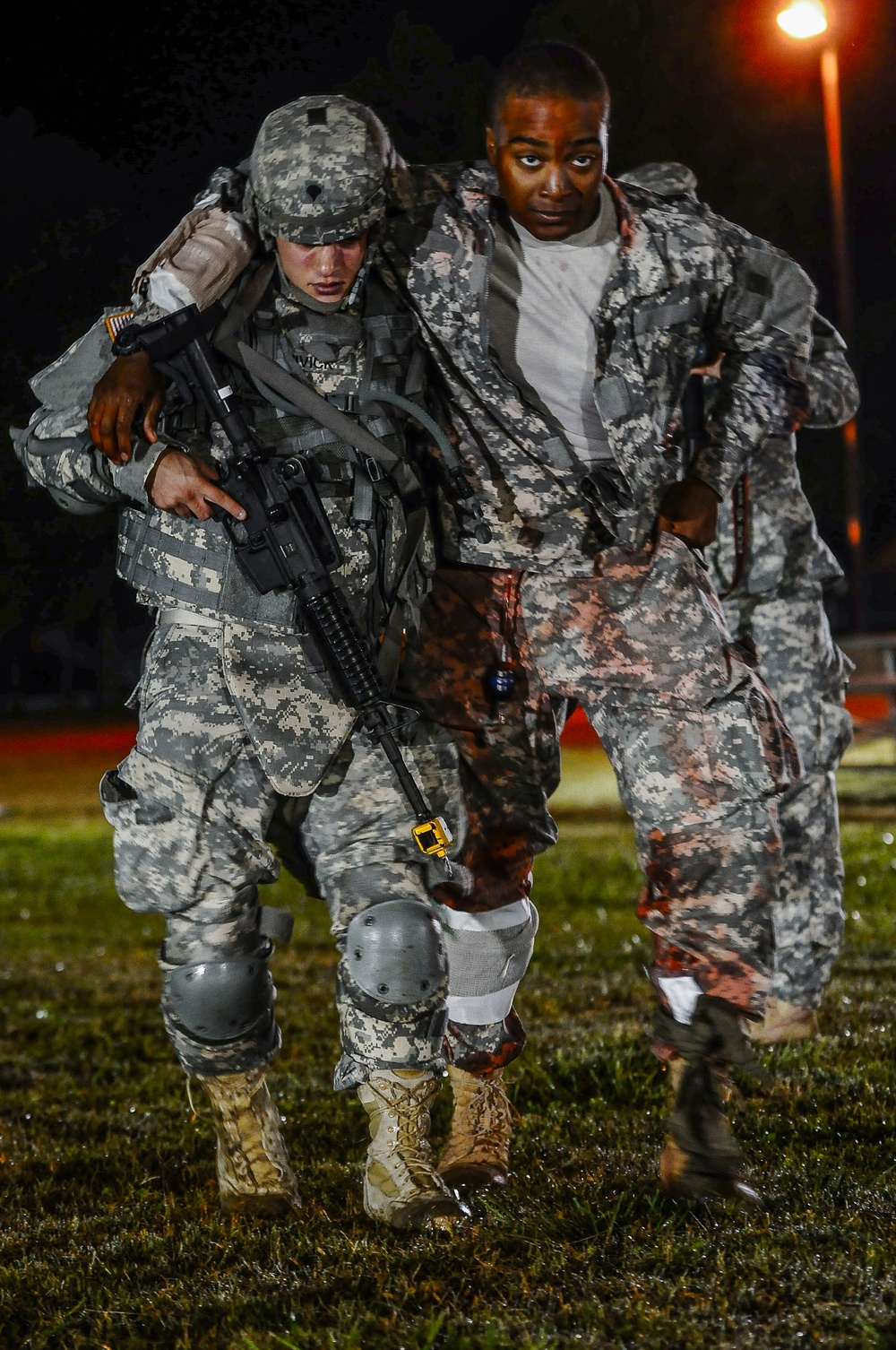 Spc. Jeremy Shivick moves a patient to the casualty collection point