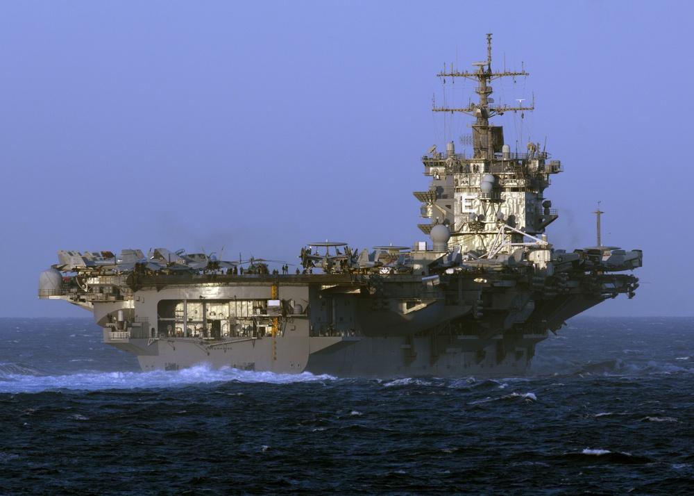 USS Enterprise passes through the Strait of Gibraltar