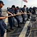 Sailors heave line during sea-and-anchor
