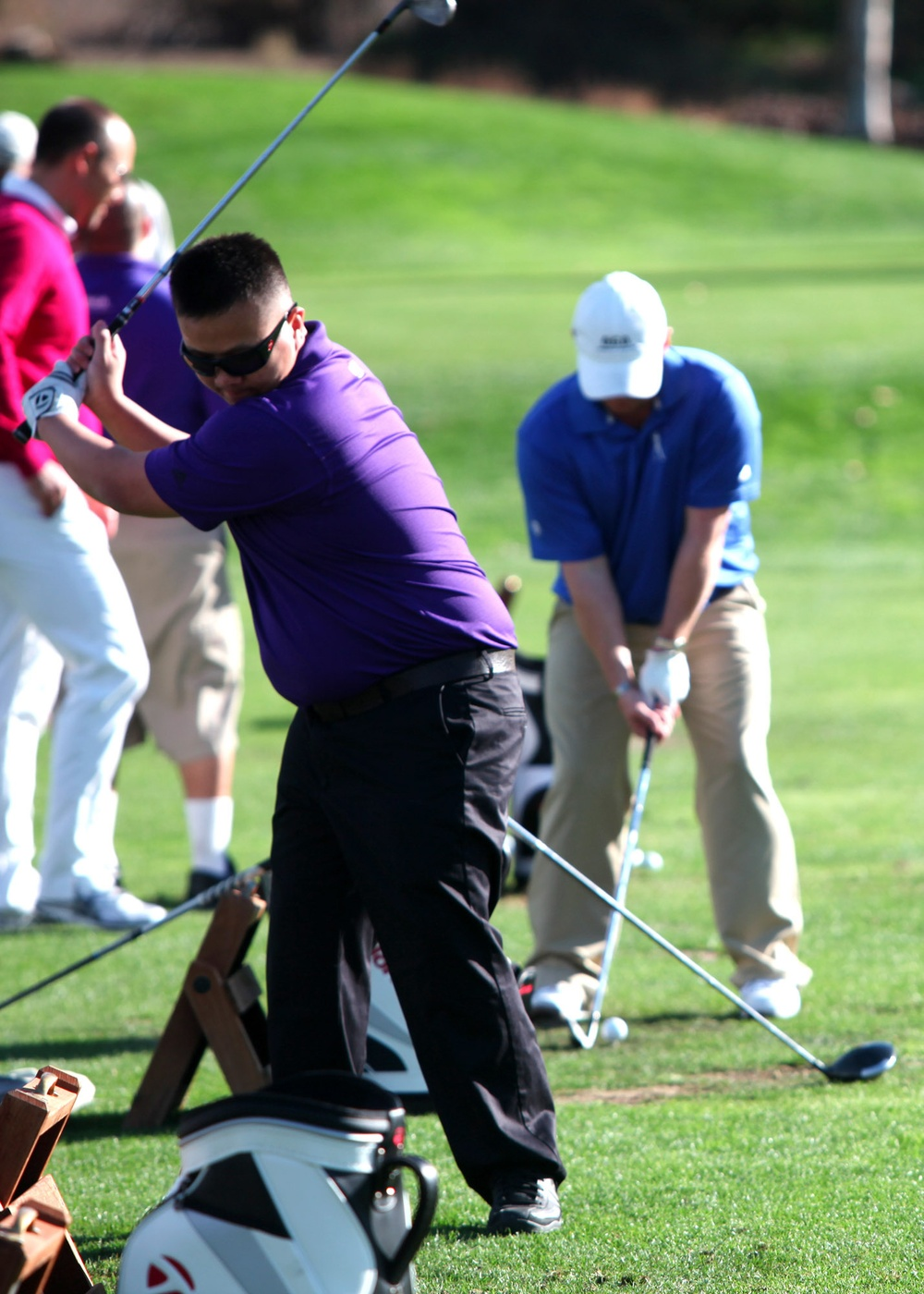 Wounded Marines rehab with pro golf help