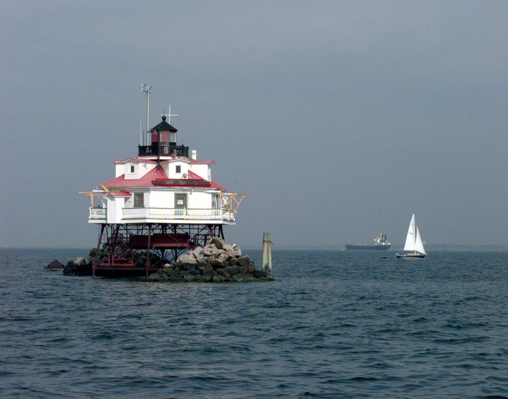 Sailboat cruises by Thomas Point Light