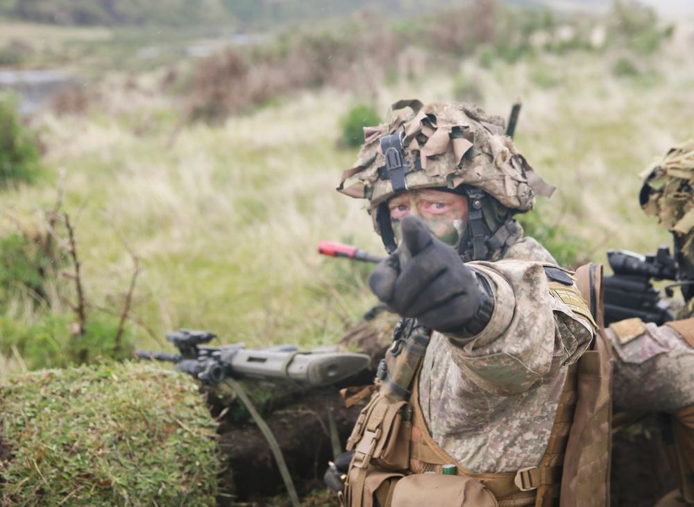 Troops repel enemy during Exercise Kiwi Koru 2014