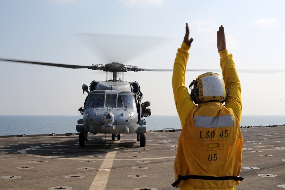Two MH-60s land aboard USS Comstock