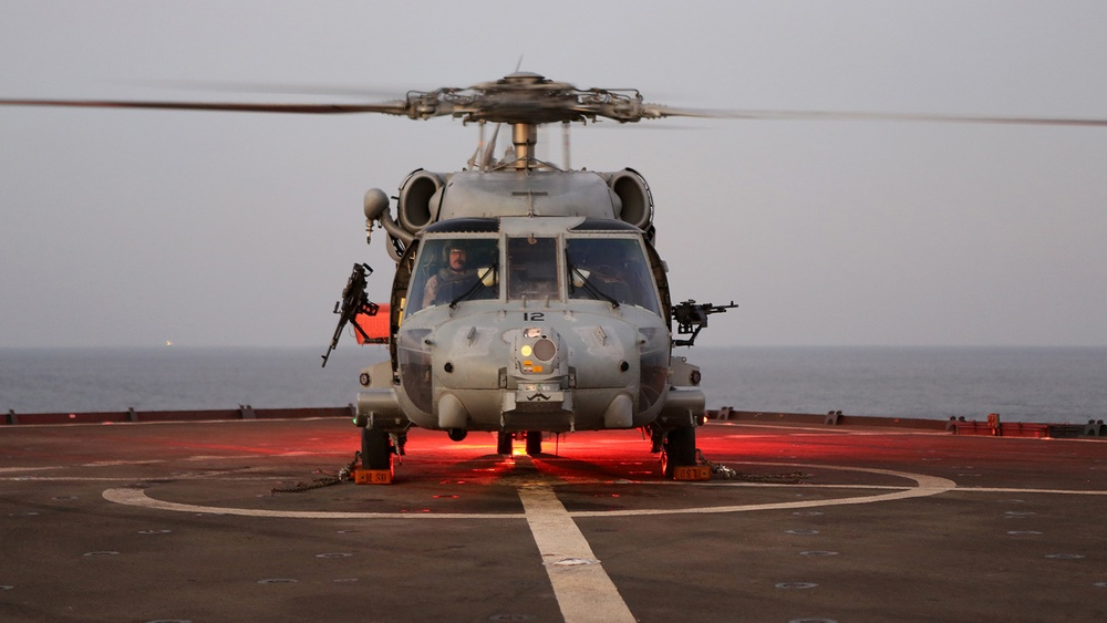 USS Comstock lands two Sea Hawks at once