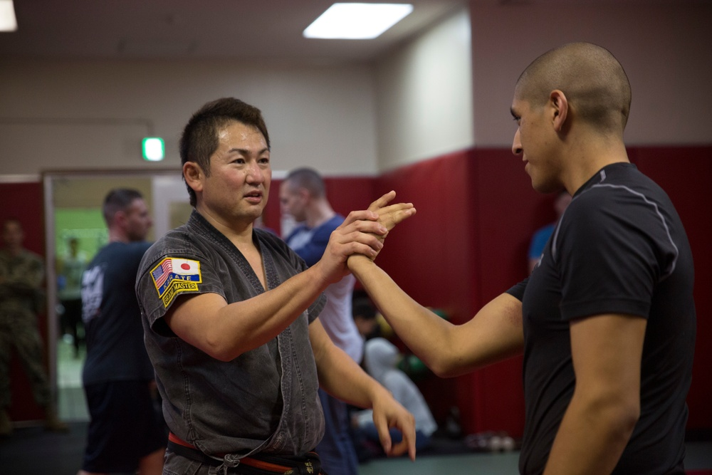Marines learn martial arts techniques from master