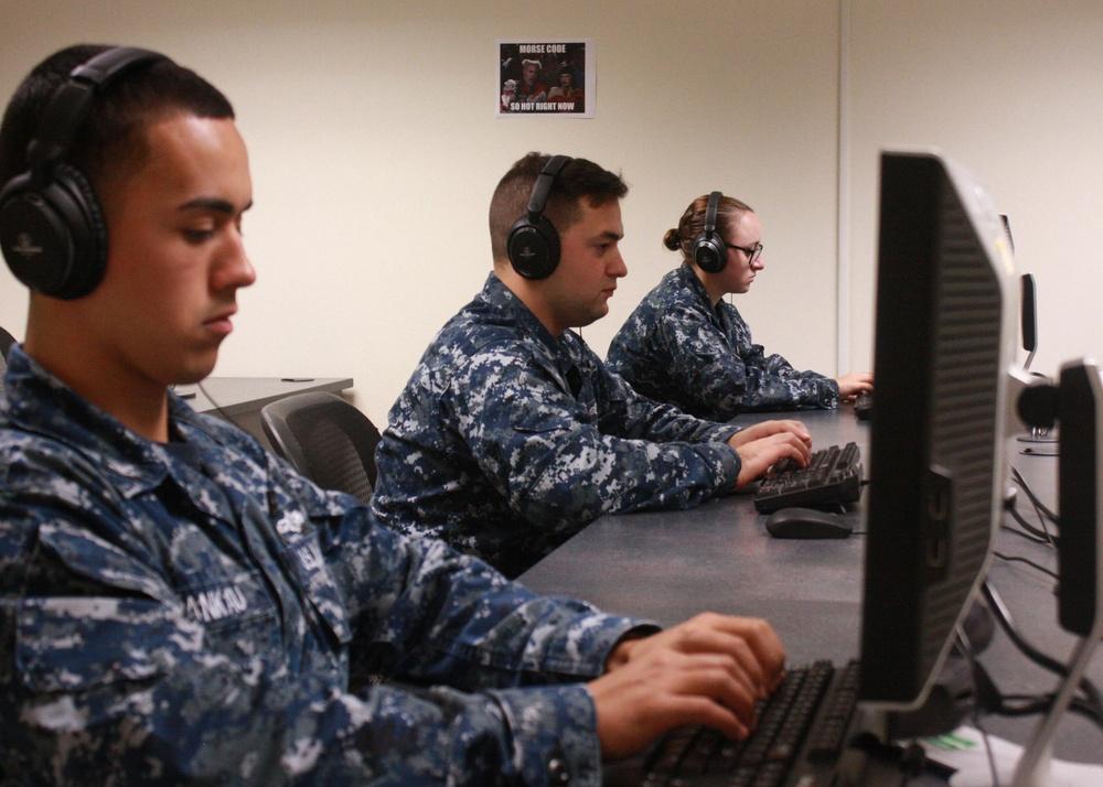 Navy cryptology students learn Morse code