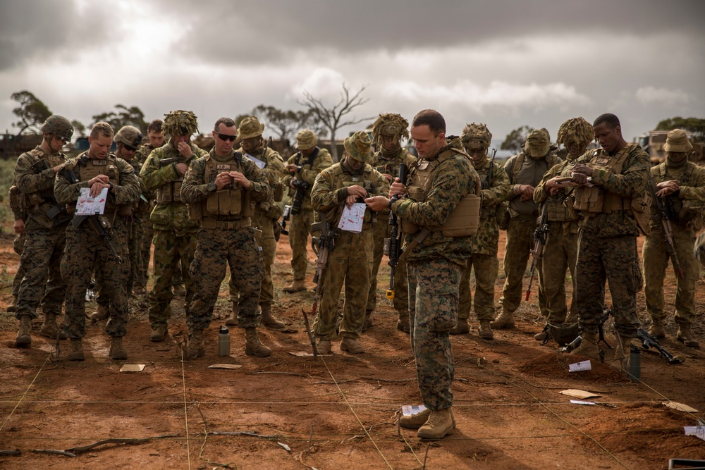 Marines and Australian soldiers move to objective