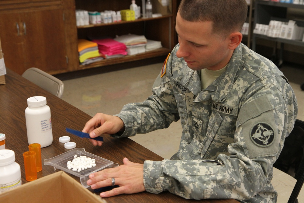 Pharmacy technician fills prescriptions during Greater Chenango Cares IRT