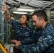 nformation Systems Technician 2nd Class Laura A. Hale, a Patuxent River, Md. native, and Electronics Technician 3rd Class Martin Rodriguez, a Nogales, Ariz. native, work together troubleshooting a high frequency receiver in the radio room aboard the amphi