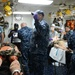 Sailors assigned to the amphibious assault ship USS Bataan (LHD 5), Fleet Surgical Team 6 and Naval Medical Center Portsmouth work together to give medical care to a simulated patient during a mass casualty drill in medical triage aboard Bataan.