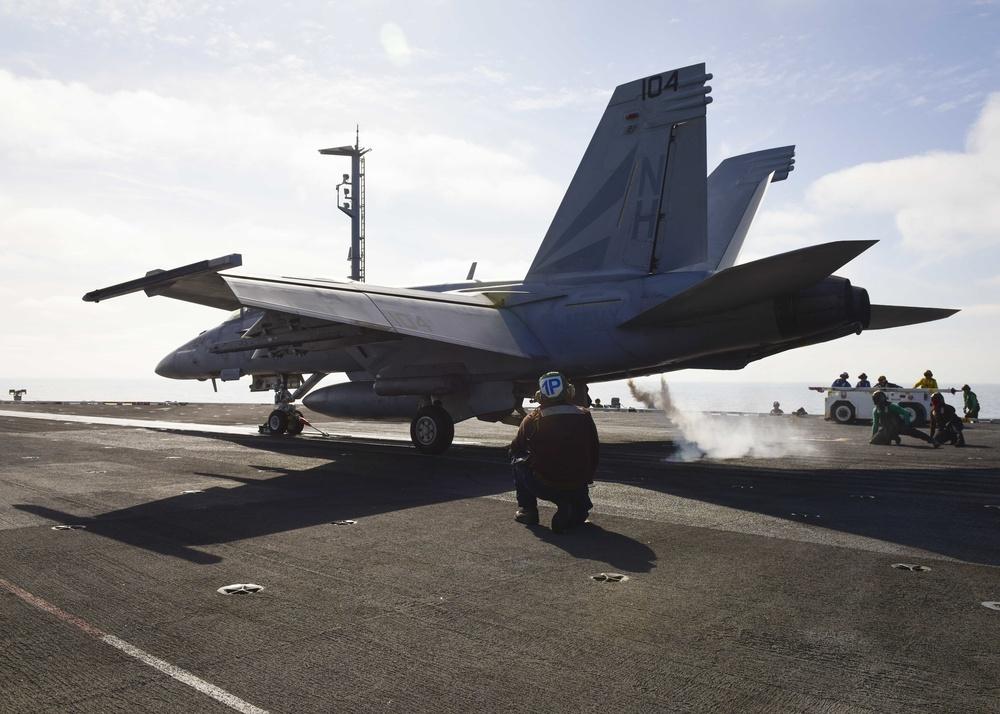An F/A-18F Super Hornet launches from flight deck