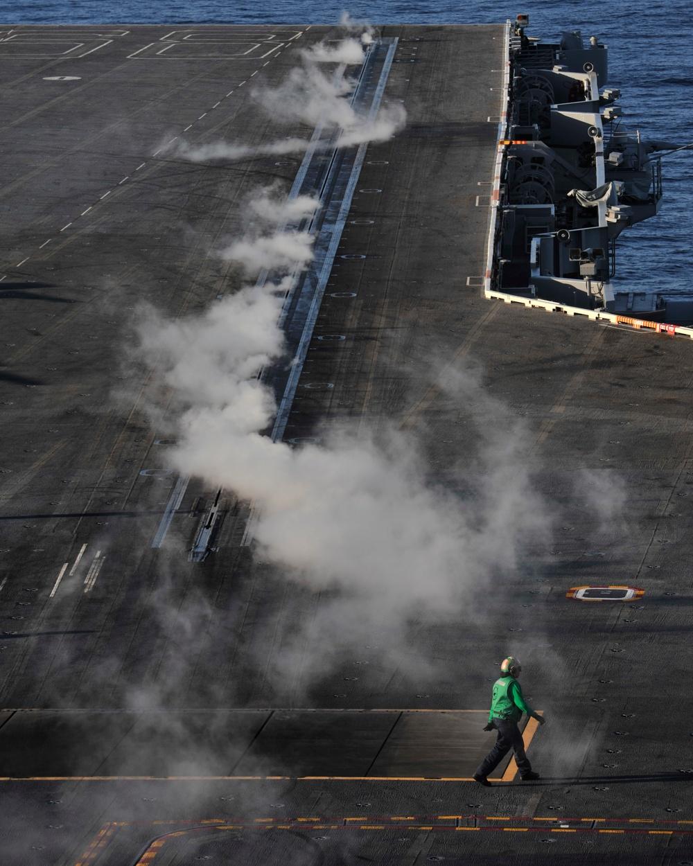 Sailor works on Nimitz flight deck