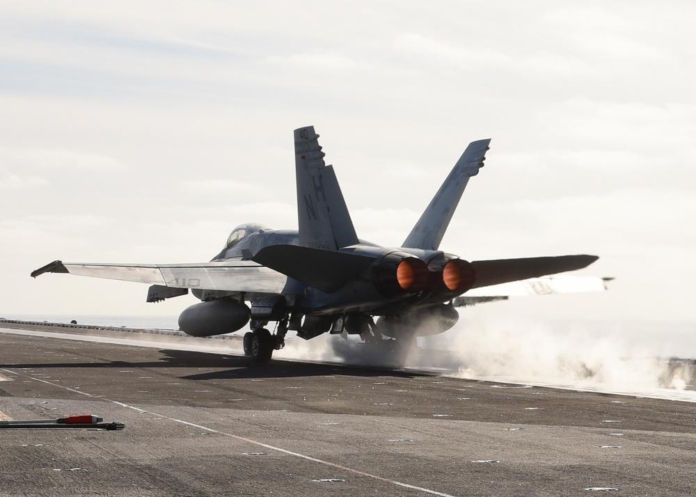An F/A-18C Hornet launches from the flight deck of USS Nimitz