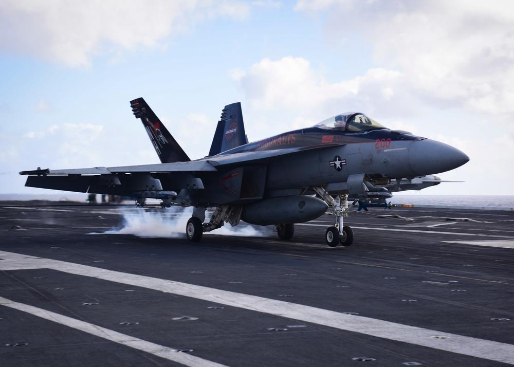 An F/A-18C Hornet lands on board USS Nimitz