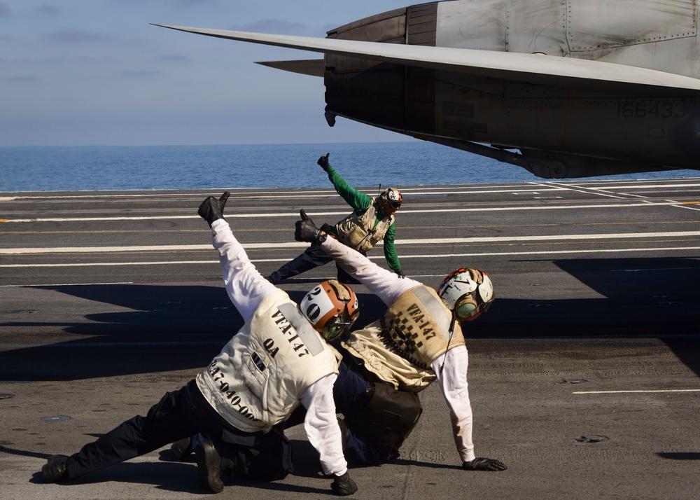 Sailors prepare to launch on board USS Nimitz