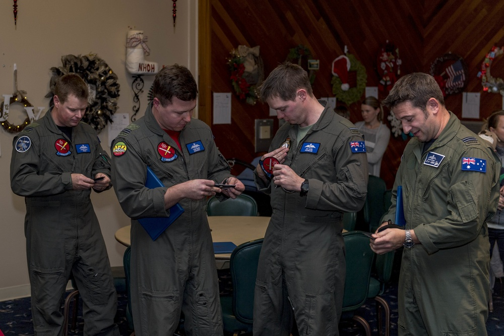 Members of the Royal Australian Air Force graduate from the EA-18G Growler pilot and electronic warfare officer pilot exchange program.