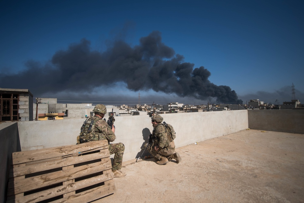 Coalition forces conduct mortar fire mission