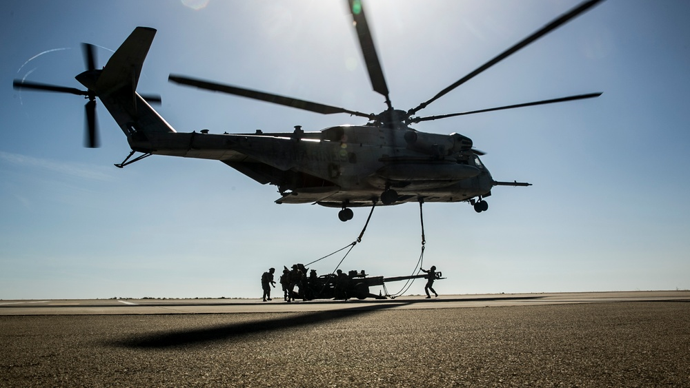 Delivering Artillery: CH-53E rapidly deploys the M777 Howitzer