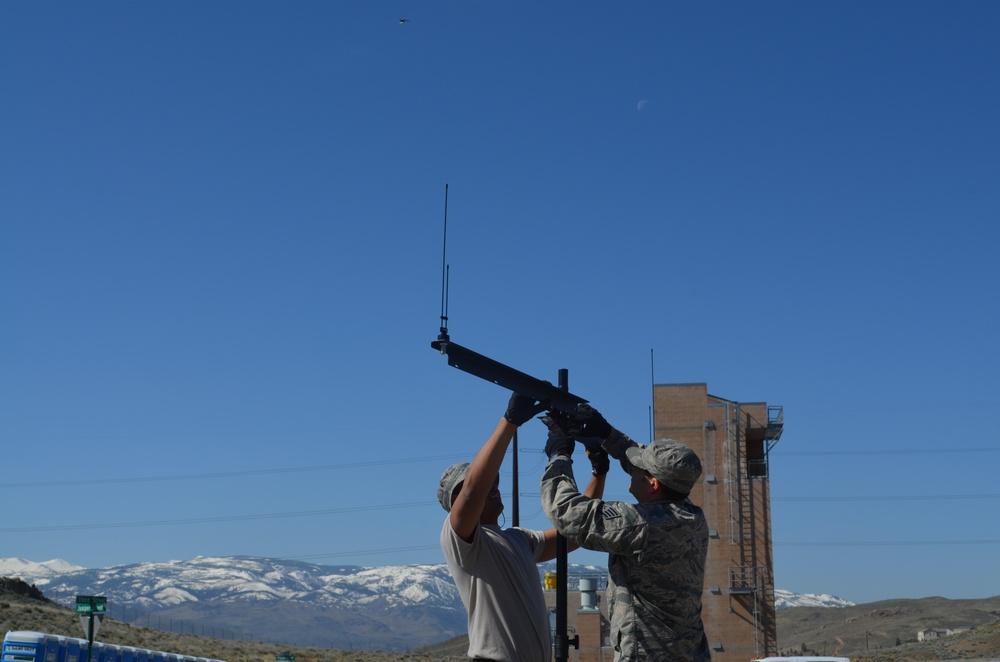 JISCC members assembling antenna mast
