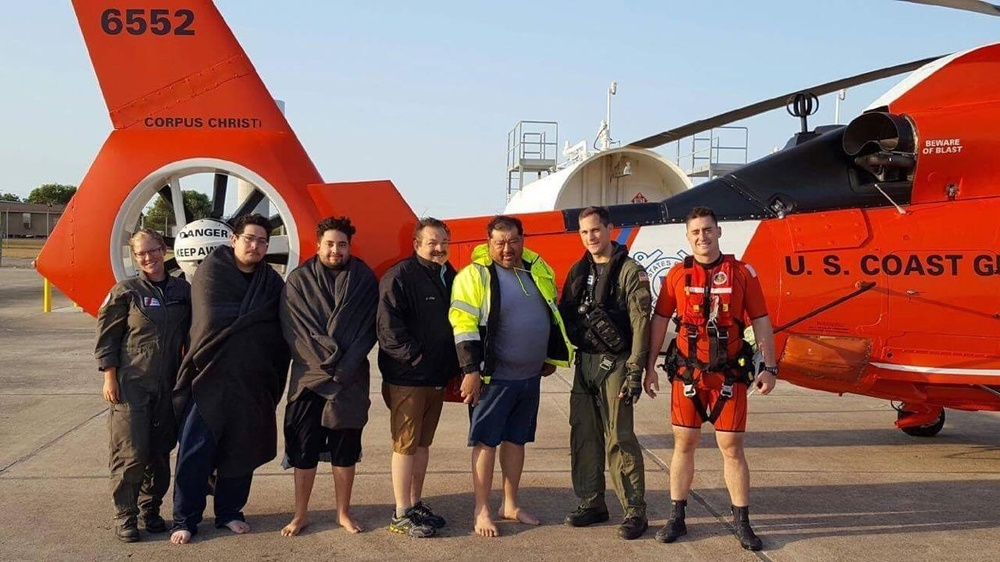 Coast guard aircrews hoist 4 people off of capsized boat