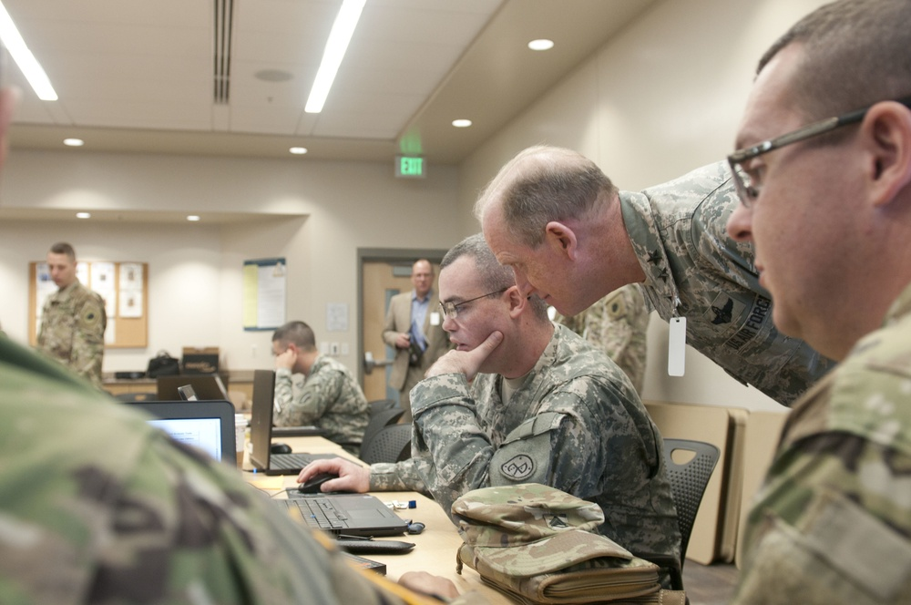 Distinguished visitors gather at Camp Williams for Cyber Shield 17
