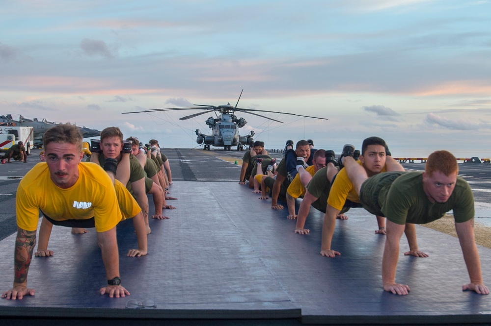 Sailors and Marines Aboard USS Bonhomme Richard (LHD 6) Build Teamwork and Strength Through Physical Training