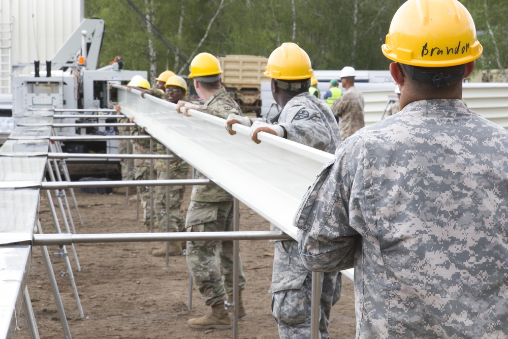 U.S. Army engineers construct a permanent structure for rotational aviation headquarters in Poland