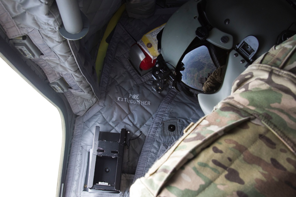 CH-47 Chinook crews monitor SOF paradrops for safety in Latvia