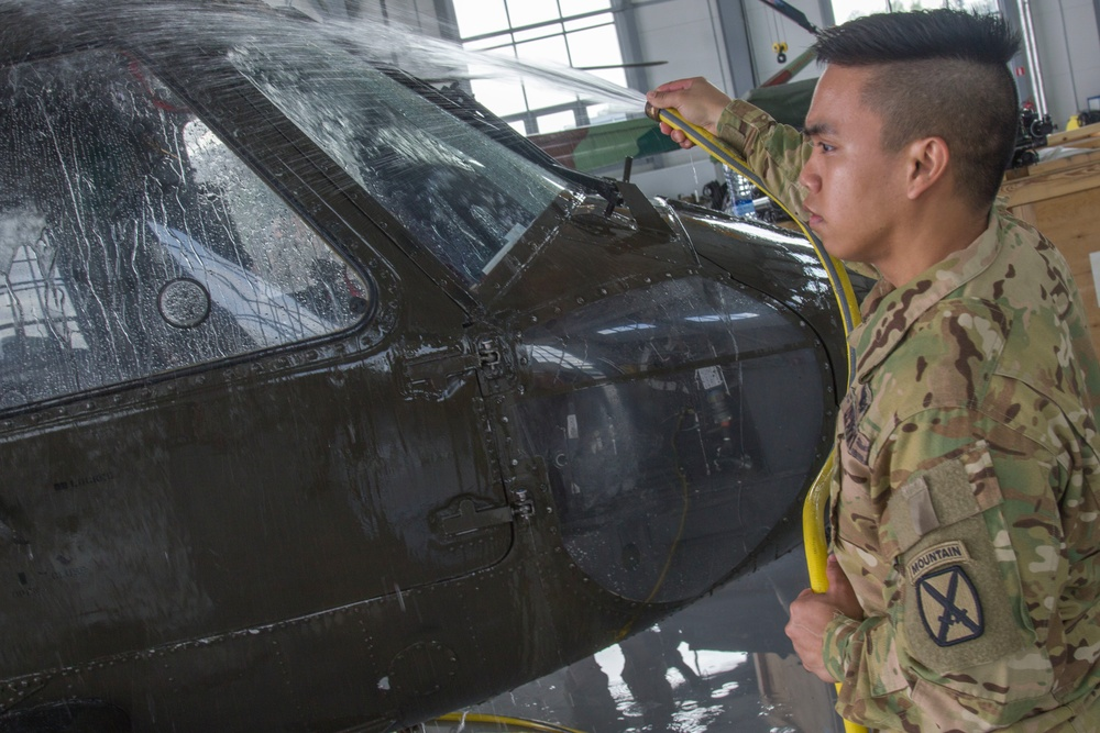 Soldiers ensure aircraft in the Baltics are corrosion free through regular checks and washes