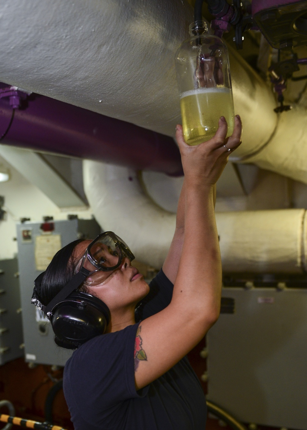 Sailors Taks Fuel Sample
