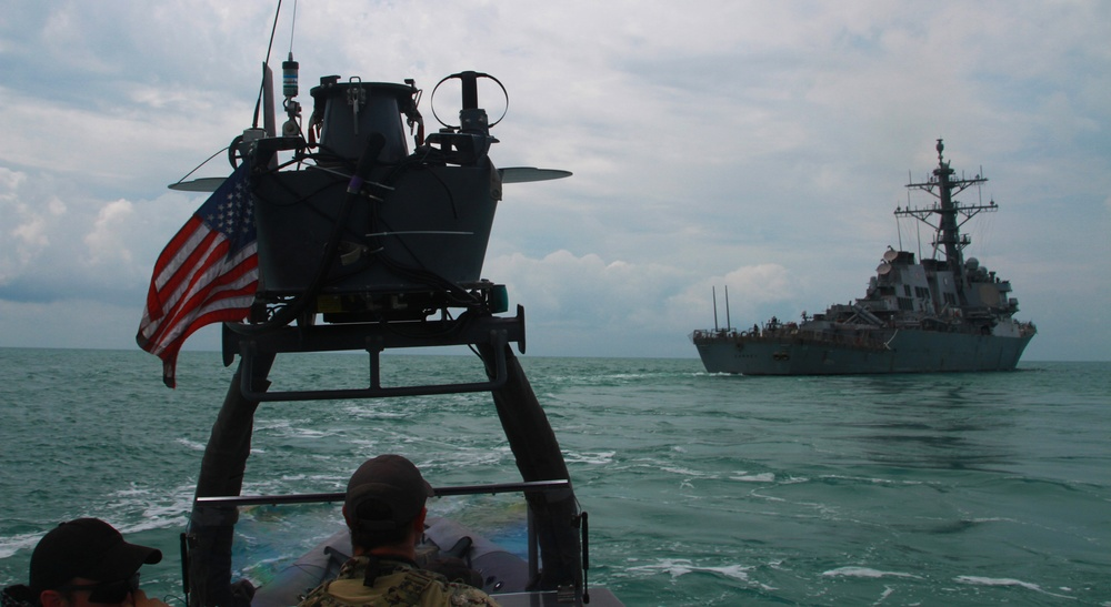 U.S. Naval Special Warfare Operators speed towards USS Carney during training exercise at Sea Breeze 17