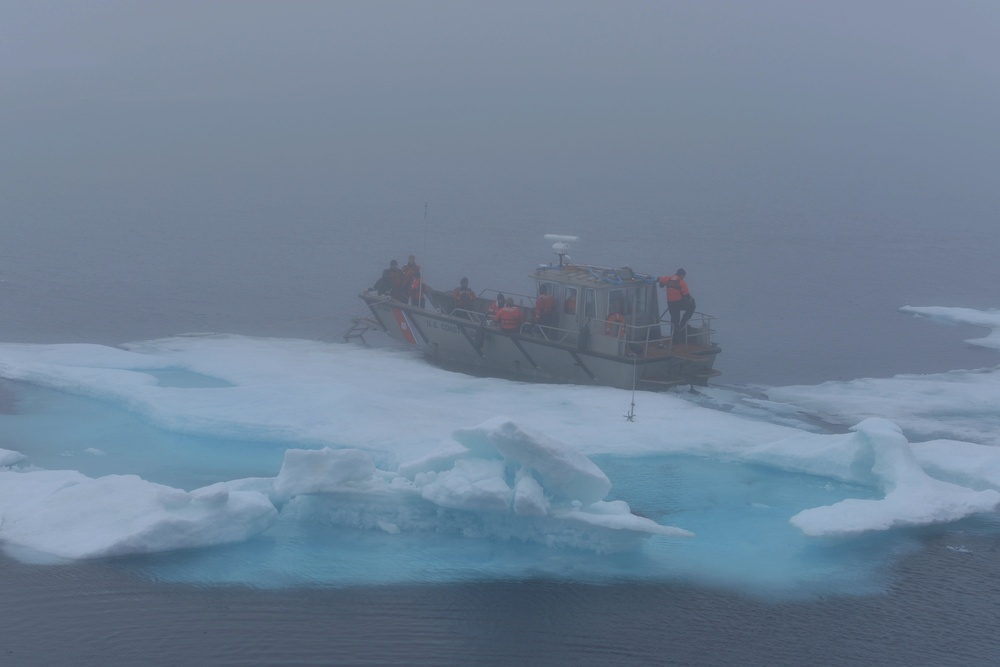 Coast Guard Cutter Healy small boat is anchored to an ice floe during cold water ice dive in the Arctic