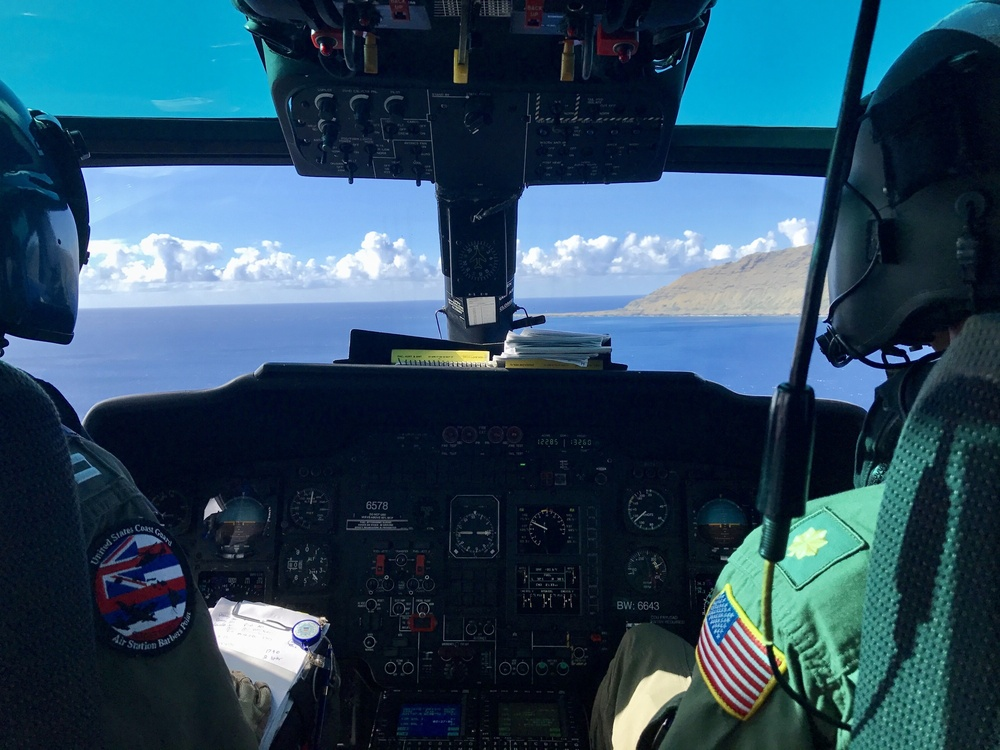 Coast Guard MH-65 Dolphin helicopter crew searches for missing aviators off Oahu