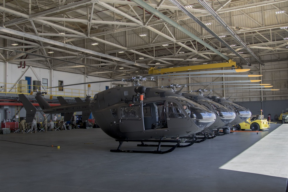 Soldiers assigned to the Nebraska Army National Guard's 1-376th Aviation Regiment (Security and Support) move the blades of three Nebraska UH-72 Lakota helicopters in together to make more space for other aircraft.