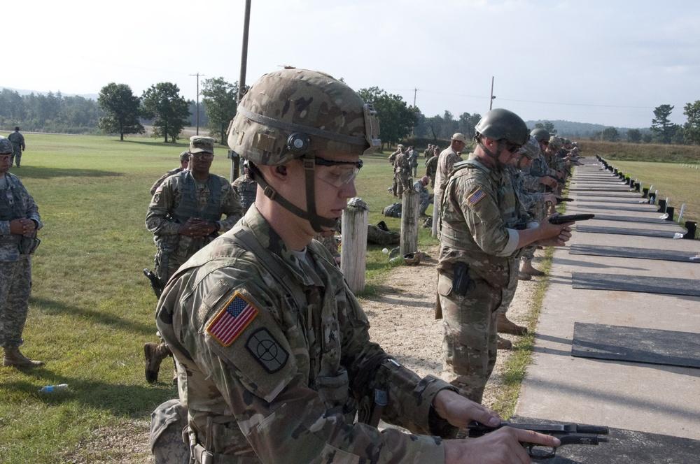 Sgt. Newlon prepares his M-9 pistol during close engagement match