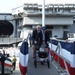 Veterans board USS Gerald R. Ford (CVN 78) prior to the ship's commissioning ceremony