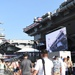 Family, friends and guests of USS Gerald R. Ford's (CVN 78) crew members walk the pier prior to the ship's commissioning ceremony