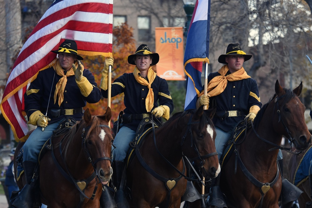 Flags flow, Opinicus stands tall during parade