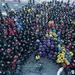 USS AMerica Sailor holds all hands call